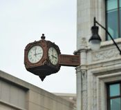Clock on a corner Royalty Free Stock Photography