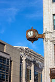 Clock on the corner of historic building in Washington DC. Stock Photos