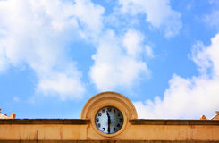 Clock in cornice Royalty Free Stock Photography