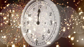 Clock counting down to midnight with fireworks