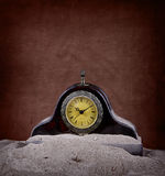 Clock covered in sand Stock Photo