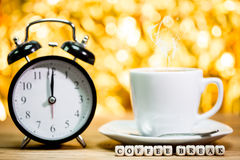 Clock. cup of fresh espresso with clock sign, Stock Photography