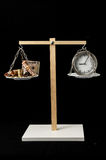 Clock and Currency Time is Money Concept Stock Photos