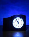 Clock in the Dark Room Royalty Free Stock Photos
