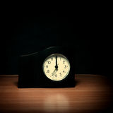 Clock in the Dark Room Royalty Free Stock Images