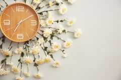 Clock decorated with flowers on wall. Closeup Royalty Free Stock Photos