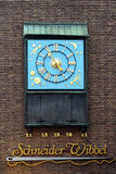 Clock dedicated to Schneider Wibbel in Dusseldorf. Dusseldorf, Chiming clock with dedicated to Schneider Wibbel - character of urban story, Germany Stock Image