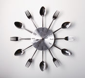 Clock design. With spoons and forks over white background Royalty Free Stock Photography