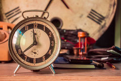 Clock on the desk Royalty Free Stock Image