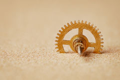 Clock detail - a gear in the sand Royalty Free Stock Images