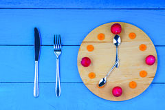 Clock dial made from vegetables with fork, knife and spoons Royalty Free Stock Photos