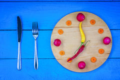 Clock dial made from vegetables with fork and knife Royalty Free Stock Photos