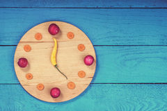 Clock dial made from vegetables Royalty Free Stock Image
