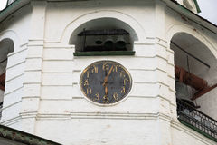 Clock on the dial that instead of numbers placed Slavonic letters.  Cathedral bell tower of the Suzdal Kremlin. Suzdal,  Vlad. Clock on the dial that instead of Royalty Free Stock Photography