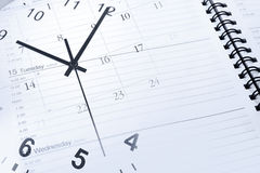 Clock and diary. Clock face and diary page Stock Image