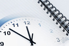 Clock and diary Stock Photography
