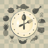 Clock and different dishes Royalty Free Stock Image