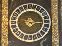 Clock in Doge`s Palace. Venice,Italy-July 25, 2018: Ancient clock in Doge`s Palace or Palazzo Ducale, Venice stock image