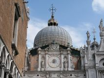 Clock in Doge`s Palace. Venice,Italy-July 25, 2018: Ancient clock in Doge`s Palace or Palazzo Ducale, Venice royalty free stock images