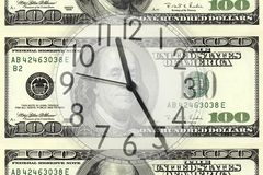 Clock on dollar Stock Images