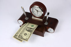 Clock and Dollar Stock Image