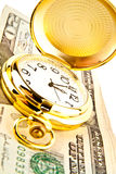 Clock and dollars Stock Photo