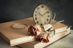 Clock with dry rose Stock Photo