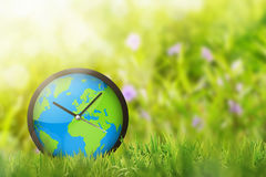 Clock of earth in the field Royalty Free Stock Photos