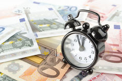 Clock and euro banknotes Royalty Free Stock Image