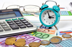 Clock and euro money. On table, close up Royalty Free Stock Image