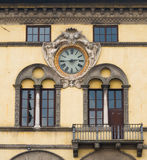 Clock on facade of ancient palace over the square of San Michele in Foro in Lucca Royalty Free Stock Photography