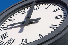 Clock Face. Large clock face with roman numerals outdoors royalty free stock images
