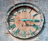 Clock Face. Old sandstone clock face with weathered hands & numbers Royalty Free Stock Images