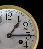 Clock face. Part of an old clock face with a black background giving an indication of time Stock Photos