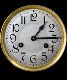 Clock face. An old and worn clock face with a black background giving an indication of time royalty free stock photo