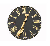 Clock Face. Roman numerals on face of clock.  Bold gold on black.  Isolated on white Stock Images