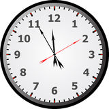 Clock face. Reading about five minutes until 12 Stock Photography