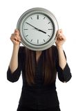 Clock Face. Business woman holding clock over face isolated on white - vertical stock images