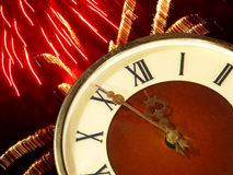 Clock face and bright firework.Eve of new year. Royalty Free Stock Photography