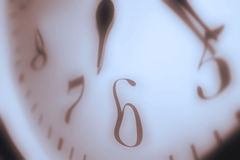 Clock Face close up. Time warp effect royalty free stock photo