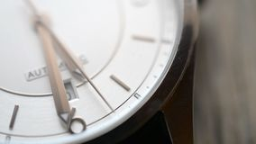 Clock face macro footage. On wooden table stock footage