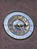 Clock Face (Norway). Church clock face showing astrology signs mounted on brick wall Stock Photo