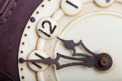 Clock face of old clock with worn numbers and arrows Royalty Free Stock Photos