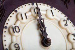 Clock face of old clock with worn numbers and arrows.  Stock Photography