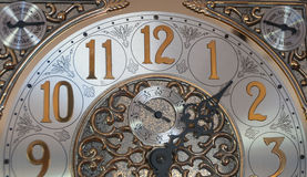 Clock Face. Ornate clock face with gold, black and silver Royalty Free Stock Image