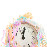 Clock face and party streamers Stock Photos