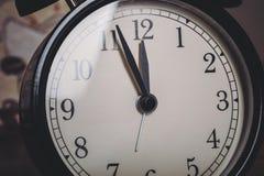 Clock face. A retro old school clock face royalty free stock photography