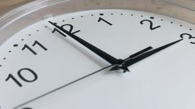 Clock face running white wall clock close-up stock video footage