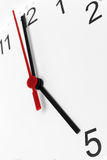 Time running. Clock face showing business working time on white background Royalty Free Stock Image