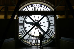 Clock face sihoutte. A silhoutte of a man at the Orsay museum in paris royalty free stock photo